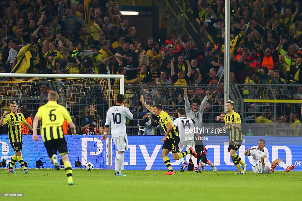 Robert Lewandowski of Borussia Dortmund turns to celebrate after scoring their third goal during the UEFA Champions League semi final first leg match between Borussia Dortmund and Real Madrid at Signal Iduna Park on April 24, 2013 in Dortmund, Germany.