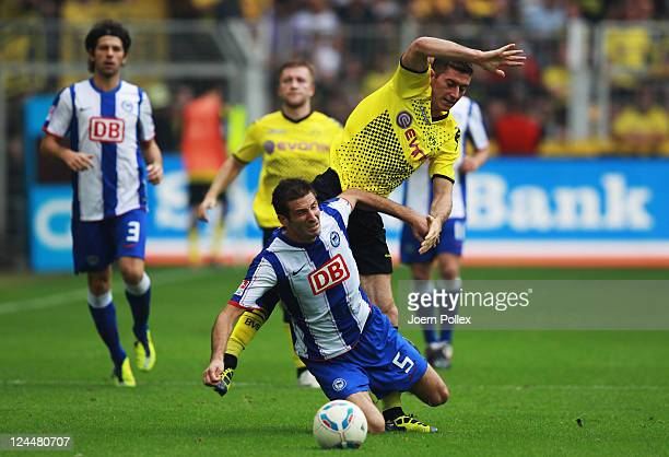 Robert Lewandowski of Dortmund and Andre Mijatovic of Berlin battle for the ball during the Bundesliga match between Borussia Dortmund and Hertha BSC...