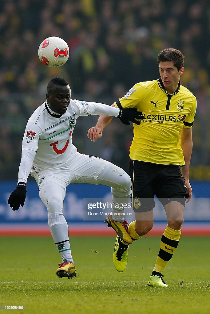 <a gi-track='captionPersonalityLinkClicked' href=/galleries/search?phrase=Robert+Lewandowski&family=editorial&specificpeople=5532633 ng-click='$event.stopPropagation()'>Robert Lewandowski</a> of Dortmund and Didier Ya Konan of Hannover battle for the ball during the Bundesliga match between Borussia Dortmund and Hannover 96 at Signal Iduna Park on March 2, 2013 in Dortmund, Germany.