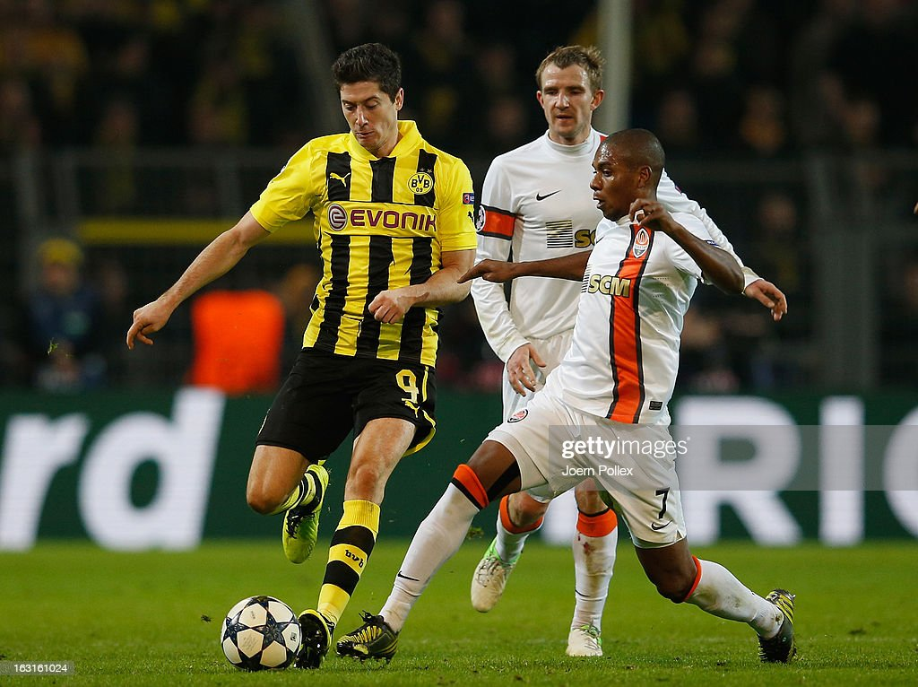 Robert Lewandowski of Dortmund and Fernandinho of Donetsk compete for the ball during the UEFA Champions League round of 16 leg match between Borussia Dortmund and Shakhtar Donetsk at Signal Iduna Park on March 5, 2013 in Dortmund, Germany.