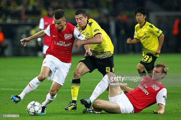 Robert Lewandowski of Dortmund and Laurent Koscielny of Arsenal battle for the ball during the Champions League Group F match between Borussia...