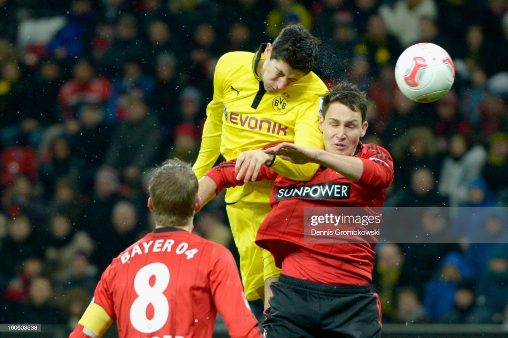 Robert Lewandowski of Dortmund and Philipp Wollscheid of Leverkusen go up for a header during the Bundesliga match between Bayer 04 Leverkusen and Borussia Dortmund at BayArena on February 3, 2013 in Leverkusen, Germany.