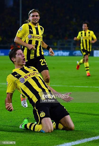 Robert Lewandowski of Dortmund celebrates after scoring his teams first goal during the UEFA Champions League group D match between Borussia Dortmund...