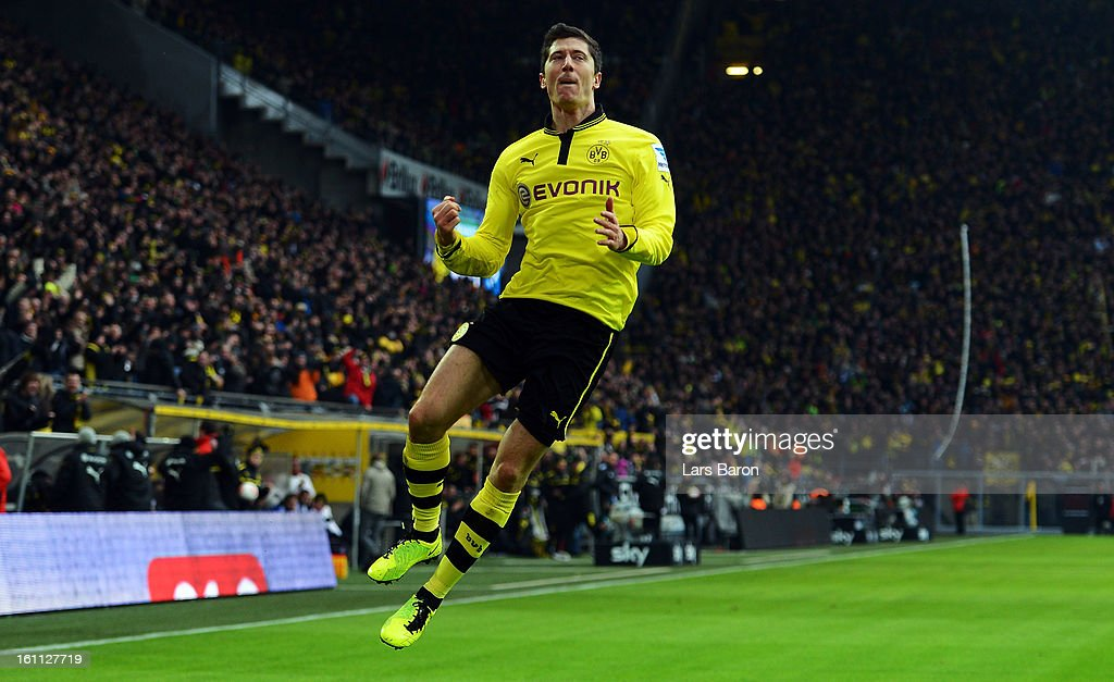 <a gi-track='captionPersonalityLinkClicked' href=/galleries/search?phrase=Robert+Lewandowski&family=editorial&specificpeople=5532633 ng-click='$event.stopPropagation()'>Robert Lewandowski</a> of Dortmund celebrates after scoring his teams first goal during the Bundesliga match between Borussia Dortmund and Hamburger SV at Signal Iduna Park on February 9, 2013 in Dortmund, Germany.
