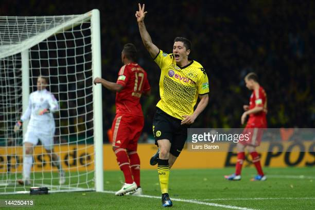 Robert Lewandowski of Dortmund celebrates after scoring his third and his teams fives goal during the DFB Cup final match between Borussia Dortmund...