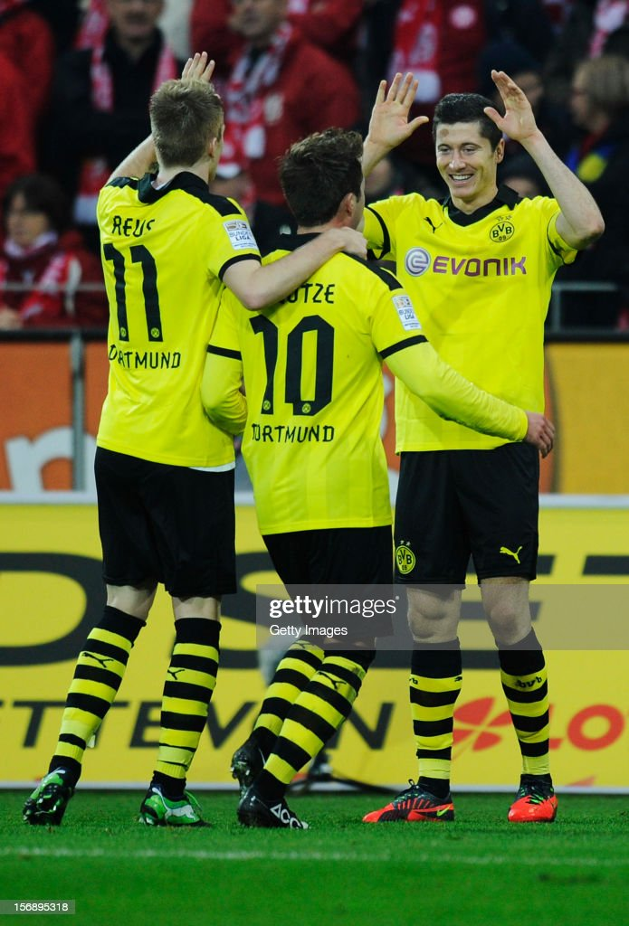 <a gi-track='captionPersonalityLinkClicked' href=/galleries/search?phrase=Robert+Lewandowski&family=editorial&specificpeople=5532633 ng-click='$event.stopPropagation()'>Robert Lewandowski</a> of Dortmund (R) celebrates his team's second goal with team mates <a gi-track='captionPersonalityLinkClicked' href=/galleries/search?phrase=Marco+Reus&family=editorial&specificpeople=5445884 ng-click='$event.stopPropagation()'>Marco Reus</a> (L) and <a gi-track='captionPersonalityLinkClicked' href=/galleries/search?phrase=Mario+Goetze&family=editorial&specificpeople=4251202 ng-click='$event.stopPropagation()'>Mario Goetze</a> during the Bundesliga match between 1. FSV Mainz 05 and Borussia Dortmund at Coface Arena on November 24, 2012 in Mainz, Germany.
