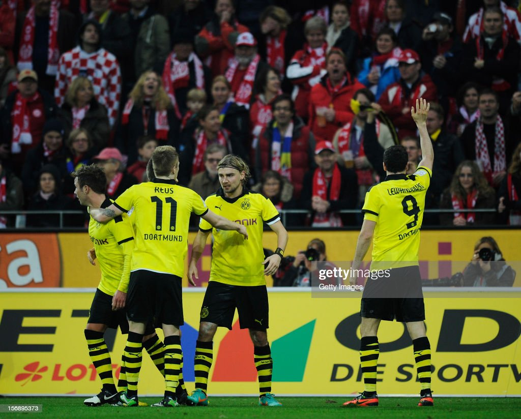 <a gi-track='captionPersonalityLinkClicked' href=/galleries/search?phrase=Robert+Lewandowski&family=editorial&specificpeople=5532633 ng-click='$event.stopPropagation()'>Robert Lewandowski</a> of Dortmund (R) celebrates his team's second goal with team mates <a gi-track='captionPersonalityLinkClicked' href=/galleries/search?phrase=Mario+Goetze&family=editorial&specificpeople=4251202 ng-click='$event.stopPropagation()'>Mario Goetze</a> (L-R), <a gi-track='captionPersonalityLinkClicked' href=/galleries/search?phrase=Marco+Reus&family=editorial&specificpeople=5445884 ng-click='$event.stopPropagation()'>Marco Reus</a> and <a gi-track='captionPersonalityLinkClicked' href=/galleries/search?phrase=Marcel+Schmelzer&family=editorial&specificpeople=5443925 ng-click='$event.stopPropagation()'>Marcel Schmelzer</a> during the Bundesliga match between 1. FSV Mainz 05 and Borussia Dortmund at Coface Arena on November 24, 2012 in Mainz, Germany.
