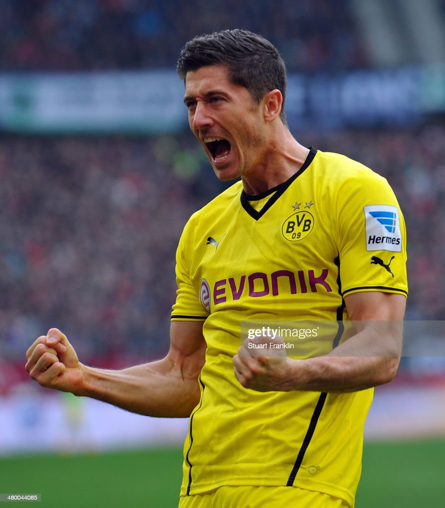 <a gi-track='captionPersonalityLinkClicked' href=/galleries/search?phrase=Robert+Lewandowski&family=editorial&specificpeople=5532633 ng-click='$event.stopPropagation()'>Robert Lewandowski</a> of Dortmund celebrates scoring his goal during the Bundesliga match between Hannover 96 and Borussia Dortmund at HDI-Arena on March 22, 2014 in Hanover, Germany.