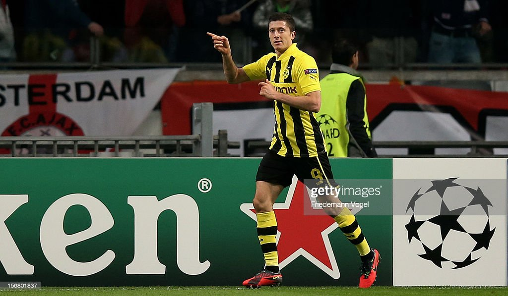 Robert Lewandowski of Dortmund celebrates scoring the third goal during the UEFA Champions League Group D match between Ajax Amsterdam and Borussia Dortmund at Amsterdam Arena on November 21, 2012 in Amsterdam, Netherlands.