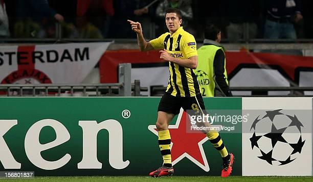 Robert Lewandowski of Dortmund celebrates scoring the third goal during the UEFA Champions League Group D match between Ajax Amsterdam and Borussia...