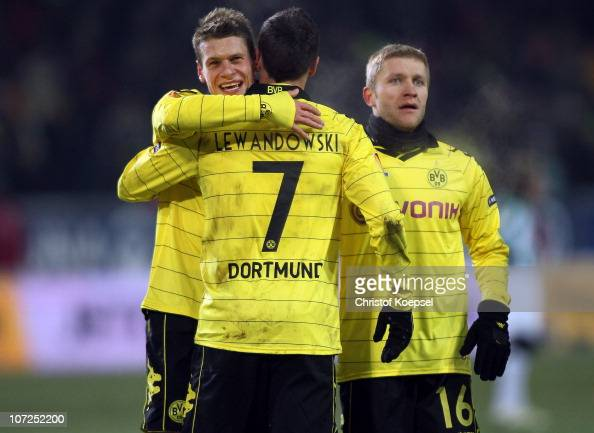 Robert Lewandowski of Dortmund celebrates the third goal with Lukasz Piszczek of Dortmund and Jakub Blaszczykowski of Dortmund during the UEFA Europa...