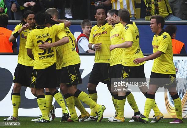 Robert Lewandowski of Dortmund celebrates with his team mates after scoring his team's second goal during the Bundesliga match between Borussia...