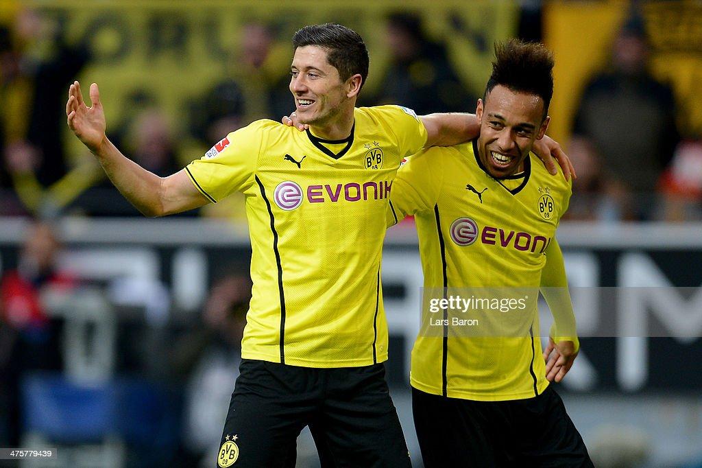 Robert Lewandowski of Dortmund celebrates with team mate PierreEmerick Aubameyang after scoring the second goal during the Bundesliga match between...