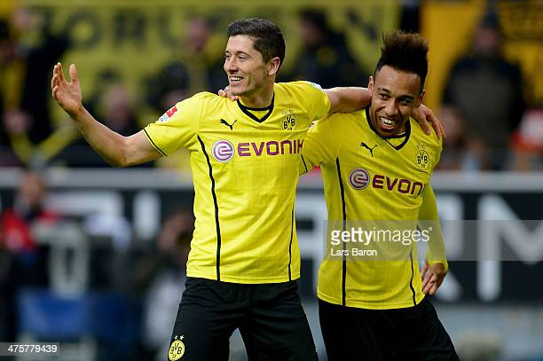 Robert Lewandowski of Dortmund celebrates with team mate PierreEmerick Aubameyang after scoring the second goal during the Bundesliga match between...