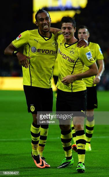 Robert Lewandowski of Dortmund celebrates with team mate Pierre Aubameyang after scoring his teams fifth goal during the Bundesliga match between...