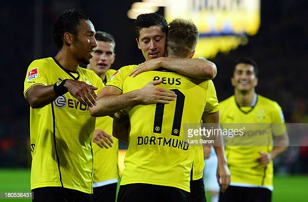 Robert Lewandowski of Dortmund celebrates with team mate Pierre Aubameyang after scoring his teams fifth goal during the Bundesliga match between...
