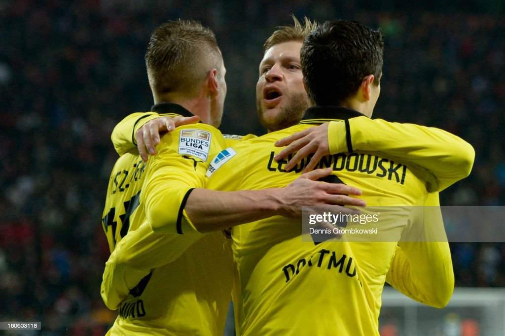Robert Lewandowski of Dortmund celebrates with teammates Lukasz Piszczek and Jakub Blaszczykowski during the Bundesliga match between Bayer 04 Leverkusen and Borussia Dortmund at BayArena on February 3, 2013 in Leverkusen, Germany.
