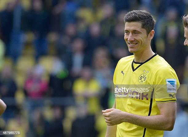 Robert Lewandowski of Dortmund celebrates with the fans after winning the Bundesliga match between Borussia Dortmund and TSG 1899 Hoffenheim at...