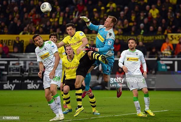 Robert Lewandowski of Dortmund goes up for a header with goalkeeper Marc Andre ter Stegen of Moenchengladbach during the Bundesliga match between...