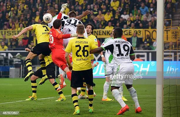 Robert Lewandowski of Dortmund heads his teams first goal during the Bundesliga match between Borussia Dortmund and VfL Wolfsburg at Signal Iduna...
