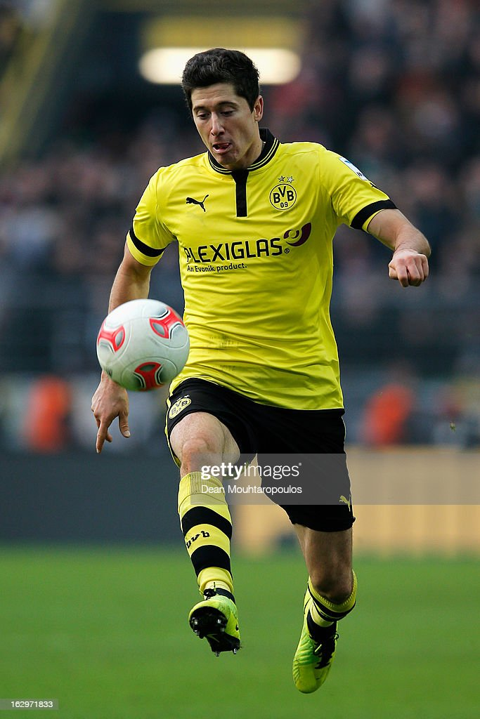<a gi-track='captionPersonalityLinkClicked' href=/galleries/search?phrase=Robert+Lewandowski&family=editorial&specificpeople=5532633 ng-click='$event.stopPropagation()'>Robert Lewandowski</a> (#9) of Dortmund in action during the Bundesliga match between Borussia Dortmund and Hannover 96 at Signal Iduna Park on March 2, 2013 in Dortmund, Germany.