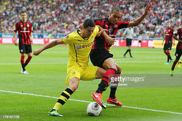 Robert Lewandowski of Dortmund is challenged by Bamba Anderson of Frankfurt during the Bundesliga match between Eintracht Frankfurt and Borussia...