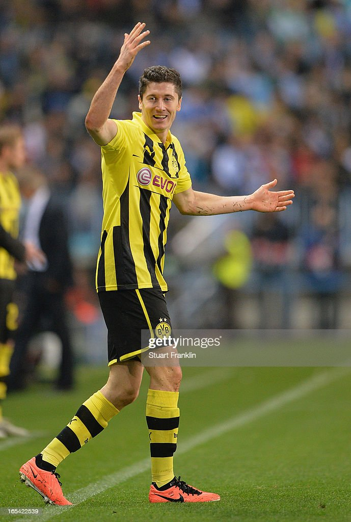 <a gi-track='captionPersonalityLinkClicked' href=/galleries/search?phrase=Robert+Lewandowski&family=editorial&specificpeople=5532633 ng-click='$event.stopPropagation()'>Robert Lewandowski</a> of Dortmund reacts during the UEFA Champion League quarter final first leg match between Malaga CF and Borussia Dortmund at La Rosaleda Stadium on April 3, 2013 in Malaga, Spain.
