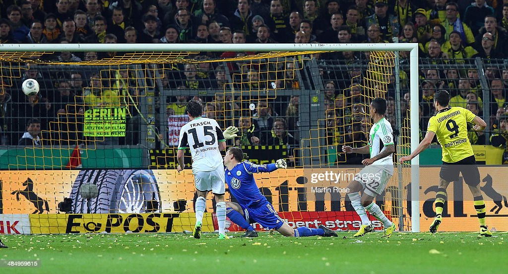 Robert Lewandowski #9 of Dortmund scores his team's 2nd goal during the the DFB Cup Semi Final match between Borussia Dortmund and VfL Wolfsburg at Signal Iduna Park on April 15, 2014 in Dortmund, Germany.
