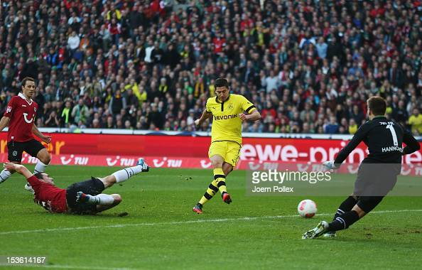 Robert Lewandowski of Dortmund scores his team's first goal during the Bundesliga match between Hannover 96 and Borussia Dortmund at AWD Arena on...