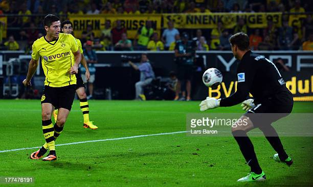 Robert Lewandowski of Dortmund scores his teams first goal during the Bundesliga match between Borussia Dortmund and Werder Bremen at Signal Iduna...