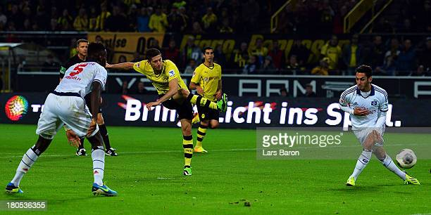 Robert Lewandowski of Dortmund scores his teams fourth goal during the Bundesliga match between Borussia Dortmund and Hamburger SV at Signal Iduna...