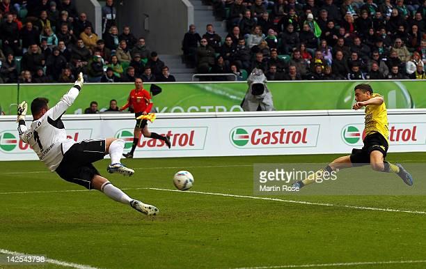 Robert Lewandowski of Dortmund scores his team's opening goal during the Bundesliga match between VfL Wolfsburg and Borussia Dortmund at the...