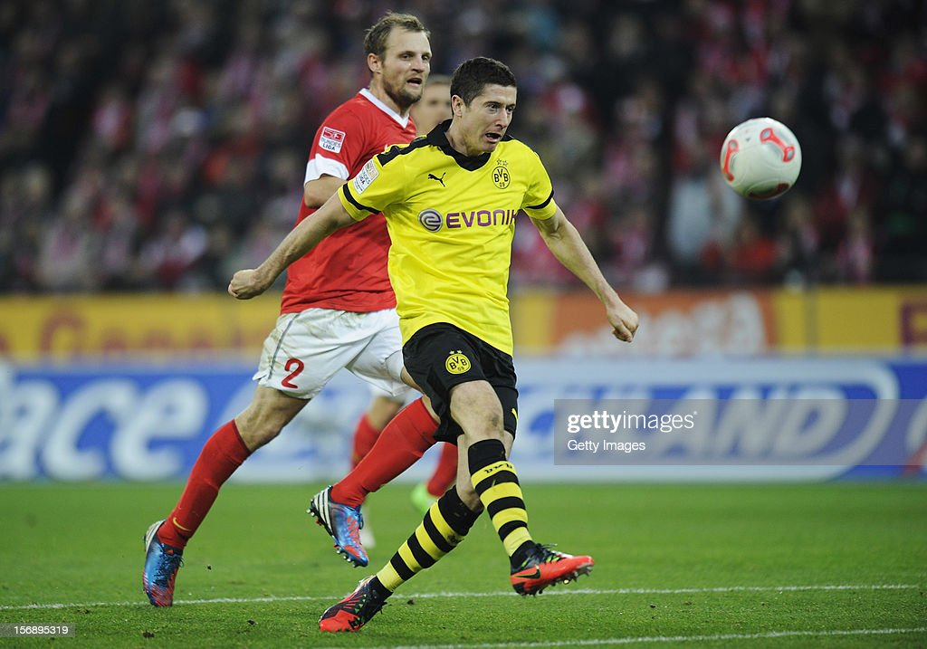 <a gi-track='captionPersonalityLinkClicked' href=/galleries/search?phrase=Robert+Lewandowski&family=editorial&specificpeople=5532633 ng-click='$event.stopPropagation()'>Robert Lewandowski</a> of Dortmund (R) scores his team's second goal next to <a gi-track='captionPersonalityLinkClicked' href=/galleries/search?phrase=Bo+Svensson&family=editorial&specificpeople=635188 ng-click='$event.stopPropagation()'>Bo Svensson</a> of Mainz during the Bundesliga match between 1. FSV Mainz 05 and Borussia Dortmund at Coface Arena on November 24, 2012 in Mainz, Germany.