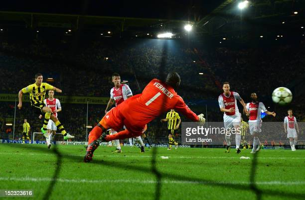 Robert Lewandowski of Dortmund scores his teams winning goal during the UEFA Champions League group D match between Borussia Dortmund and Ajax...