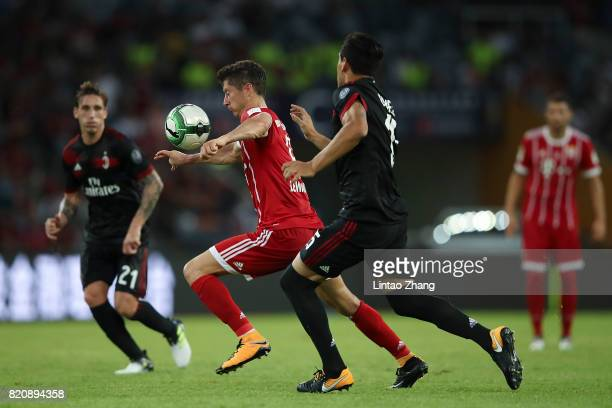 Robert Lewandowski of FC Bayern competes for the ball with Gustavo Gomez of AC Milan during the 2017 International Champions Cup China match between...