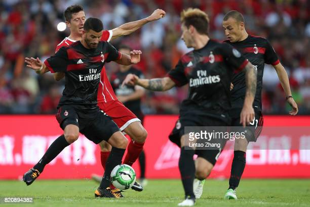 Robert Lewandowski of FC Bayern competes for the ball with Lucas Biglia and Mateo Musacchio of AC Milan during the 2017 International Champions Cup...