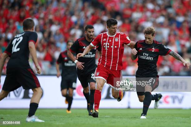 Robert Lewandowski of FC Bayern competes for the ball with Lucas Biglia of AC Milan during the 2017 International Champions Cup China match between...