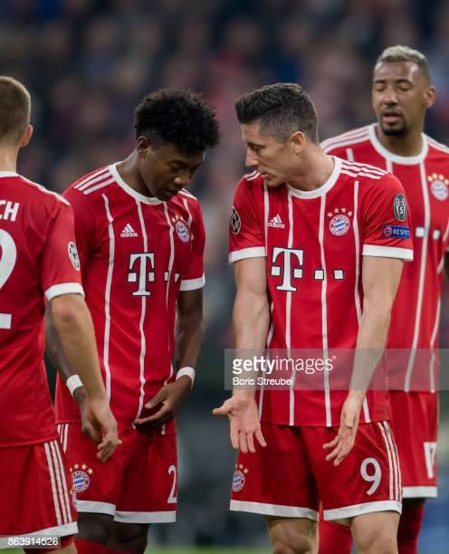 Robert Lewandowski of FC Bayern Muenchen and David Alaba of FC Bayern Muenchen reacts during the UEFA Champions League group B match between Bayern...