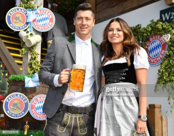 Robert Lewandowski of FC Bayern Muenchen and his wife Anna Stachurska attend the Oktoberfest beer festival at Kaefer Wiesnschaenke tent at...