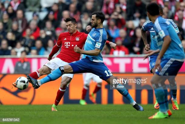Robert Lewandowski of FC Bayern Muenchen and Mergim Mavraj of Hamburg battle for the ball during the Bundesliga match between Bayern Muenchen and...