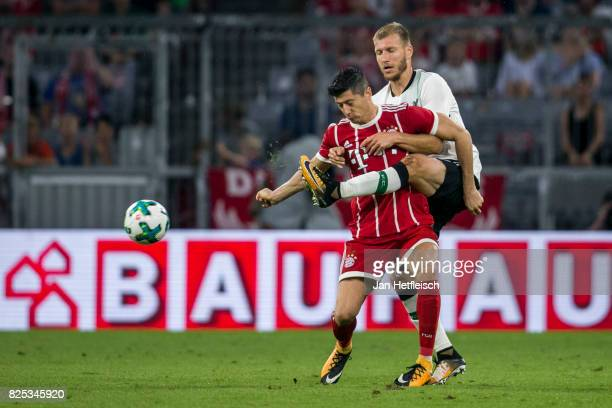 Robert Lewandowski of FC Bayern Muenchen and Ragnar Klavan of FC Liverpool a player of Liverpool FC fight for the ball during the Audi Cup 2017 match...