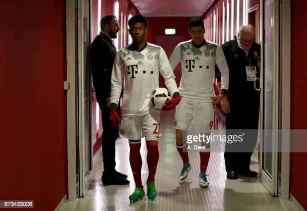 Robert Lewandowski of FC Bayern Muenchen and team mate David Alaba arrive at the players' tunnel before the DFB Cup semi final match between FC...
