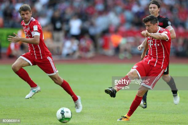 Robert Lewandowski of FC Bayern Muenchen attempts a shot with Thomas Muller of FC Bayern Muenchen during the 2017 International Champions Cup...