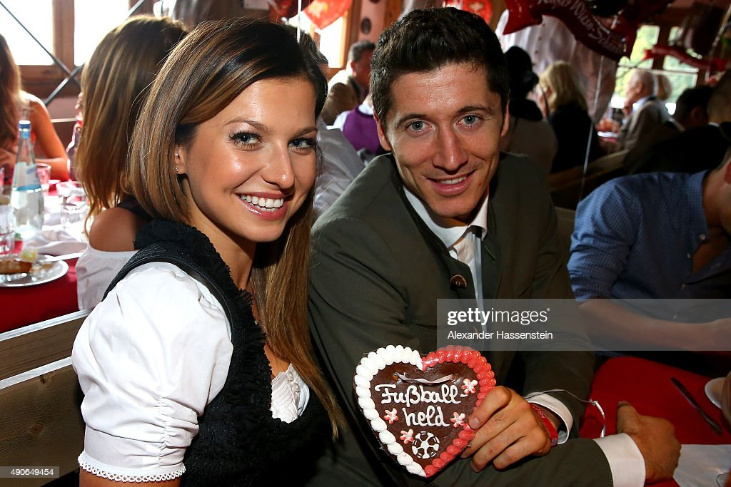 Robert Lewandowski of FC Bayern Muenchen attends with Anna Stachurska the Oktoberfest 2015 Beerfestival at Kaefer Wiesenschaenke at Theresienwiese on September 30, 2015 in Munich, Germany.