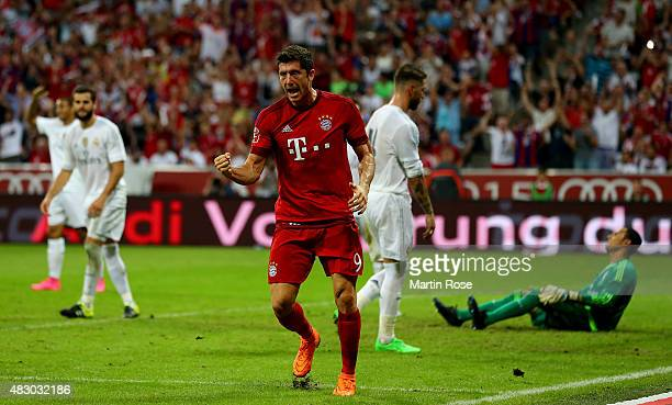 Robert Lewandowski of FC Bayern Muenchen celebrate after scoring the winning goal during the Audi Cup 2015 final match between FC Bayern Muenchen and...