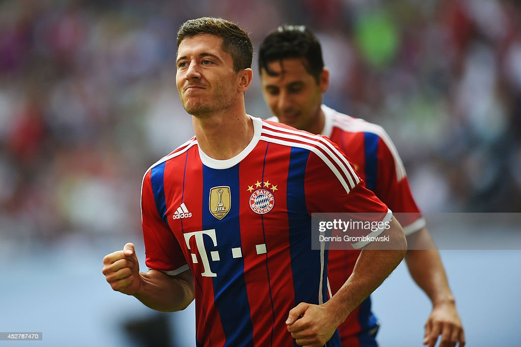 <a gi-track='captionPersonalityLinkClicked' href=/galleries/search?phrase=Robert+Lewandowski&family=editorial&specificpeople=5532633 ng-click='$event.stopPropagation()'>Robert Lewandowski</a> of FC Bayern Muenchen celebrates after scoring his team's first goal during the Telekom Cup 2014 final match between FC Bayern Muenchen and VfL Wolfsburg at Imtech Arena on July 27, 2014 in Hamburg, Germany.