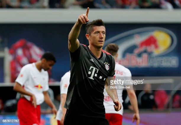 Robert Lewandowski of FC Bayern Muenchen celebrates after scoring his team's first goal by penalty during the Bundesliga match between RB Leipzig and...