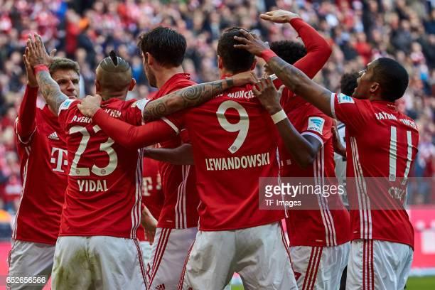 Robert Lewandowski of FC Bayern Muenchen celebrates his first goal with teammates during the Bundesliga match between Bayern Muenchen and Eintracht...