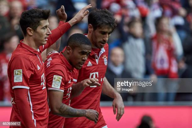 Robert Lewandowski of FC Bayern Muenchen celebrates his first goal with teammates during the Bundesliga match between Bayern Muenchen and Eintracht...