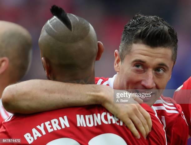 Robert Lewandowski of FC Bayern Muenchen celebrates his first goal with teammate Arturo Vidal during the Bundesliga match between FC Bayern Muenchen...